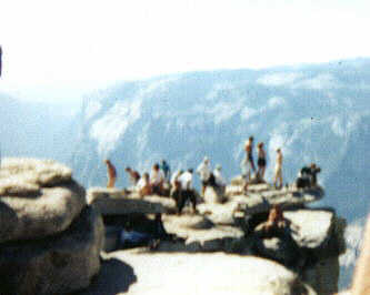 Picture of College Students standing on top edge of Half Dome.